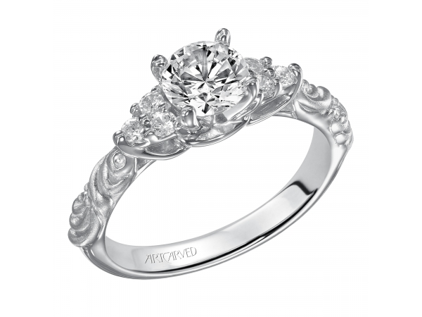 Gossimer - Diamond engagement ring with round center stone, clustered side diamonds and satin finished floral carving detail highlighted with diamonds.