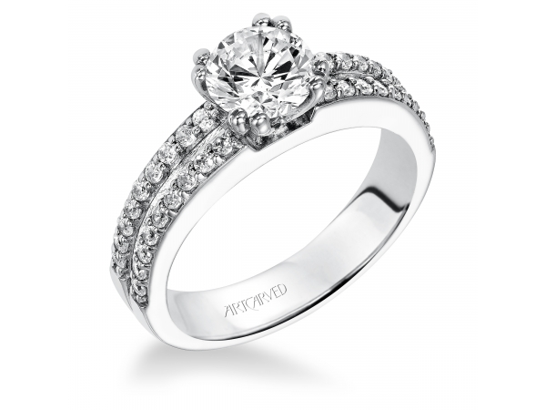 Jade - Diamond engagement ring with round center stone and diamond enhanced band.