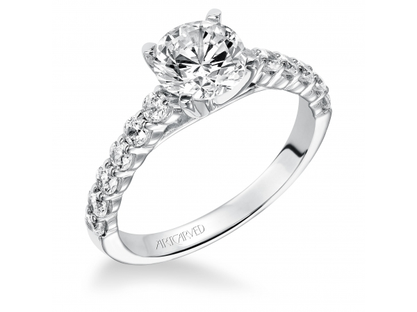 Natalie - Diamond engagement ring with round center stone and round prong set diamonds in the band.