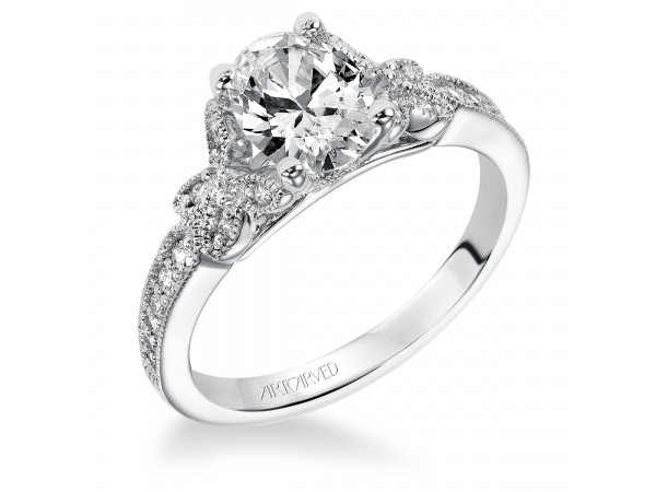 Valerie - Diamond engagement ring with oval shaped center stone and diamond enhanced band.