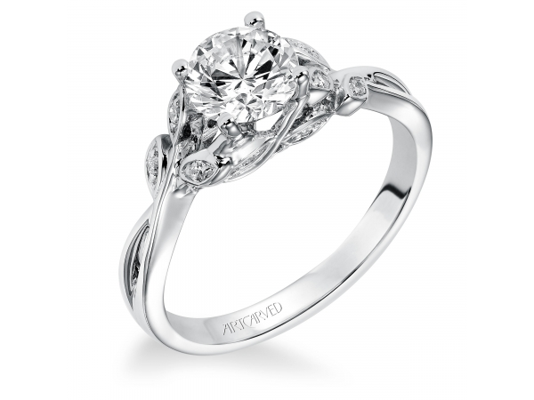 Corinne - Diamond engagement ring with round center stone and diamond enhanced band.