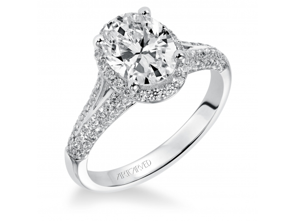 Ariel - Diamond engagement ring with oval shaped center stone surrounded by round diamonds and a pave diamond enhanced band.