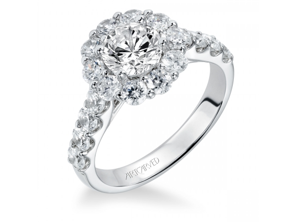 Carly - Diamond engagement ring with round center stone surrounded by round diamonds and a diamond enhanced band.