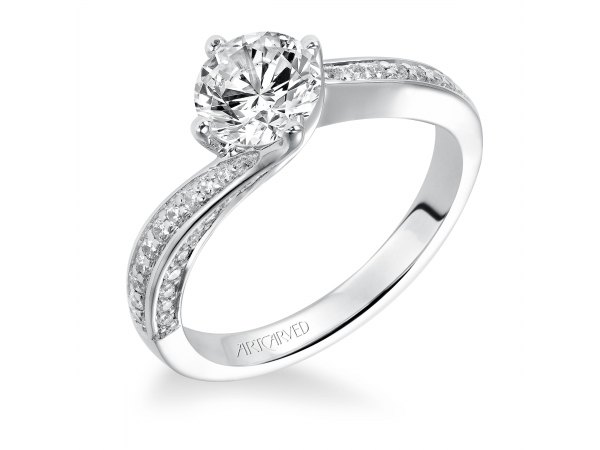 Ellie - Diamond engagement ring with round center stone set in a twist setting and a pave diamond band.