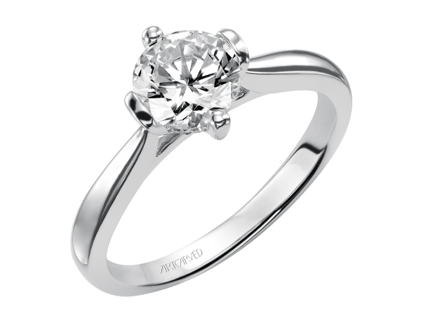 Nancy - Solitaire engagement ring with polished band.