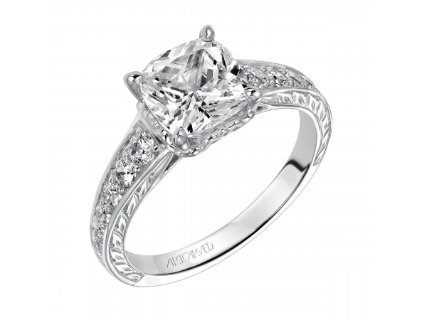 Anastasia - Diamond engagement ring with graduated prong set diamonds. This ring is enhanced with a beautiful engraved design on the shank.