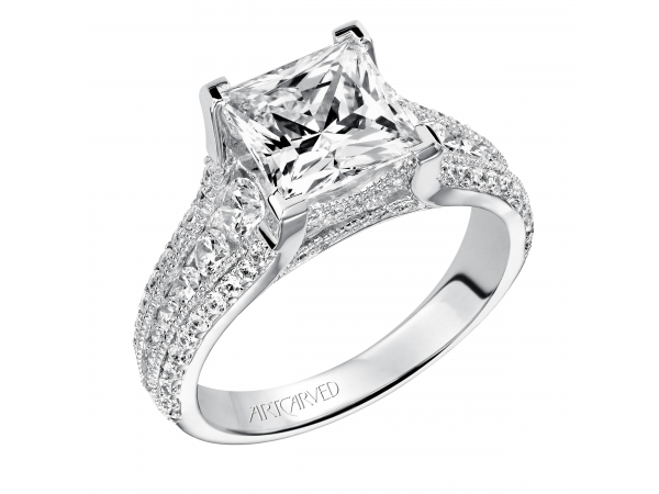 Harper - Estate diamond engagement ring features channel set graduated round diamonds with milgrain detail and prong set diamonds on the shank. Milgrain detail is also feature under the center stone.