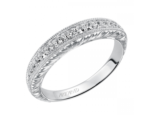 Artcarved Anniversary Band - Engraved knife edge anniversary band with round prong set diamonds and milgrain borders, totaling 1/4 carat.