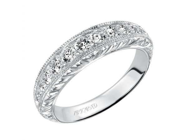 Artcarved Anniversary Band - Engraved knife edge anniversary band with round prong set diamonds and milgrain borders, totaling 1/2 carat.