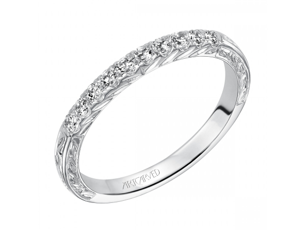 Artcarved Anniversary Band - Engraved anniversary band with round prong set diamonds totaling 1/4 carat.