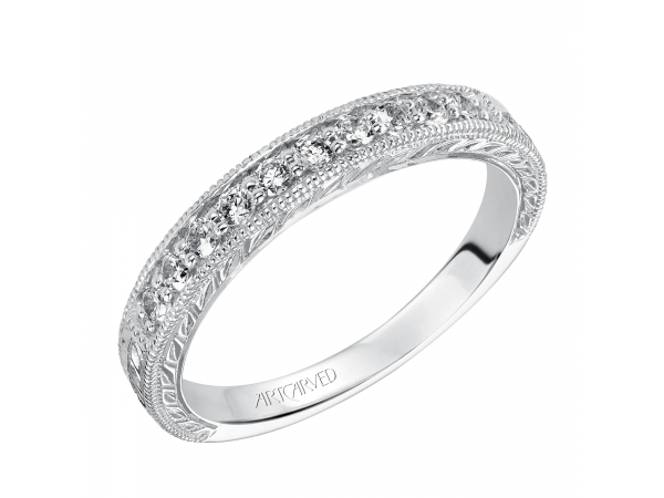 Artcarved Anniversary Band - Engraved anniversary band with round prong set diamonds and milgrain borders totaling 1/4 carat.