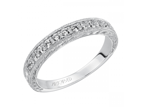 Artcarved Anniversary Band - Engraved anniversary band with round prong set diamonds and milgrain borders totaling 1/3 carat.